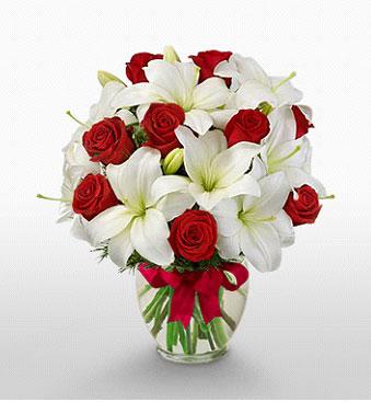 Tokat çiçek mağazası , çiçekçi adresleri  1 dal kazablanka 11 adet kırmızı gül vazosu